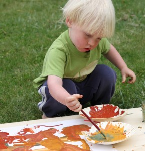 Child painting with natural non toxic paints